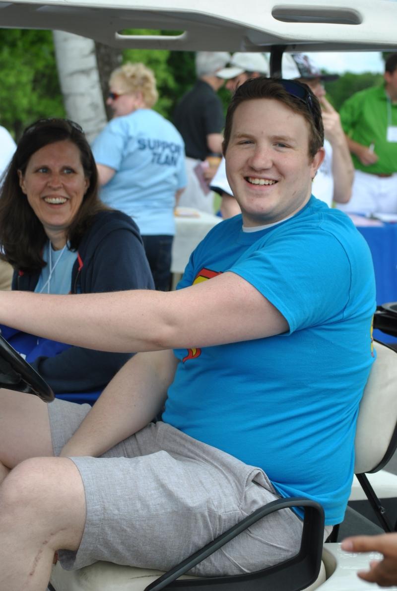 man in cart wearing blue shirt