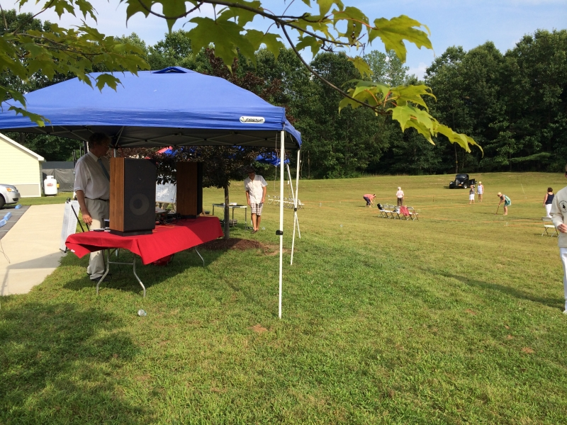 popup tent next to field