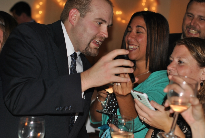 man showing woman picture on cellphone