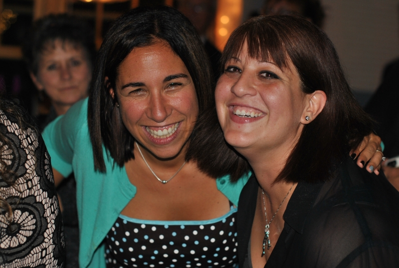 two women smiling big