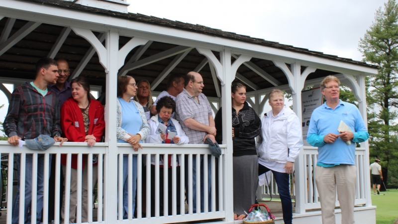 people standing in gazebo