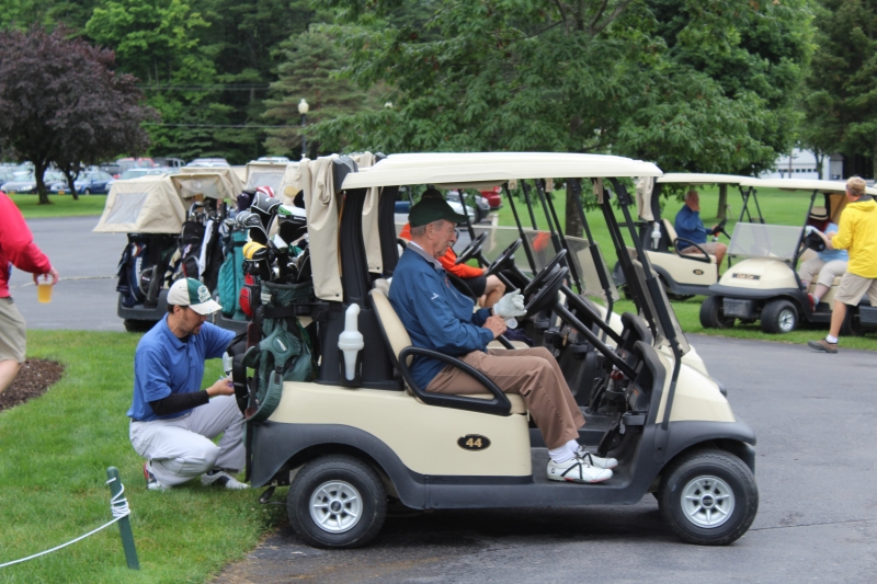 golfer in cart