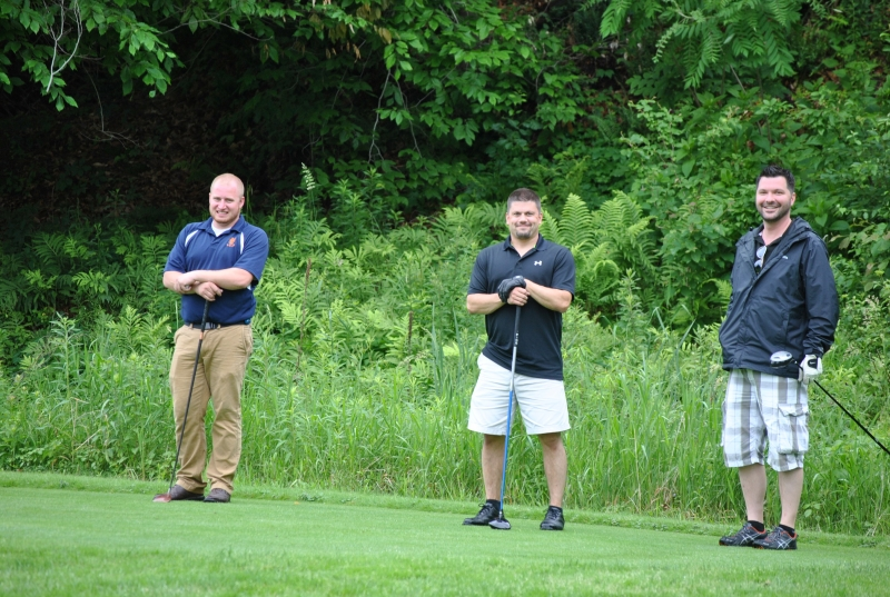guys laughing on the tee box