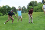 guys trying to distract a golfer while chipping