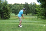 golfer in blue lining up his shot