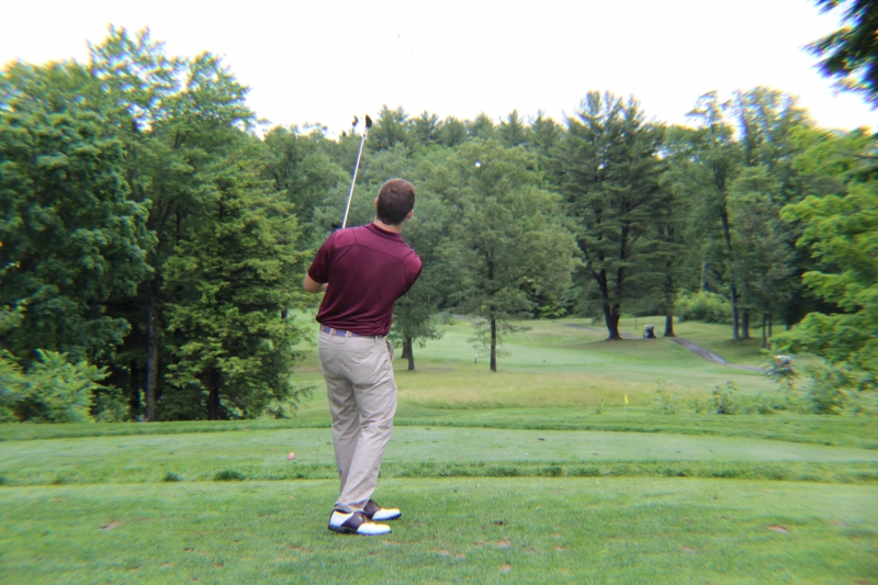 man teeing off on par three
