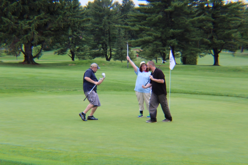 group of golfers celebrating