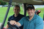 golfers in cart smiling