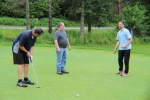 group practicing putting