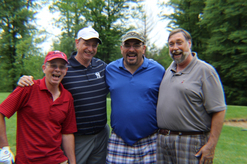 group of golfers laughing hard