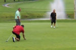 man lining up his putt