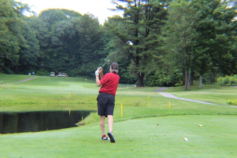 man driving off the tee box