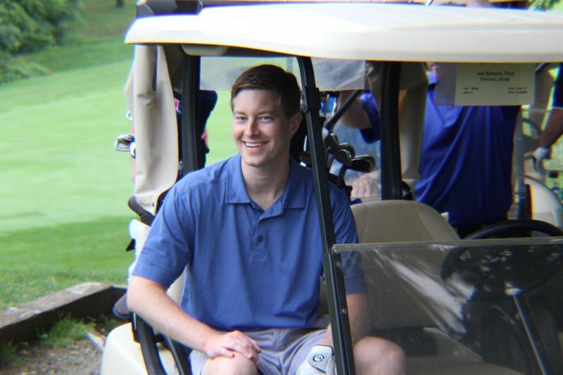 young man golfing