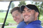 close up of two golfers smiling