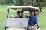 golfers in their cart toasting a beer