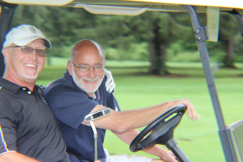 two golfers in their cart