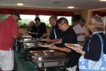 golfers getting food from the buffet