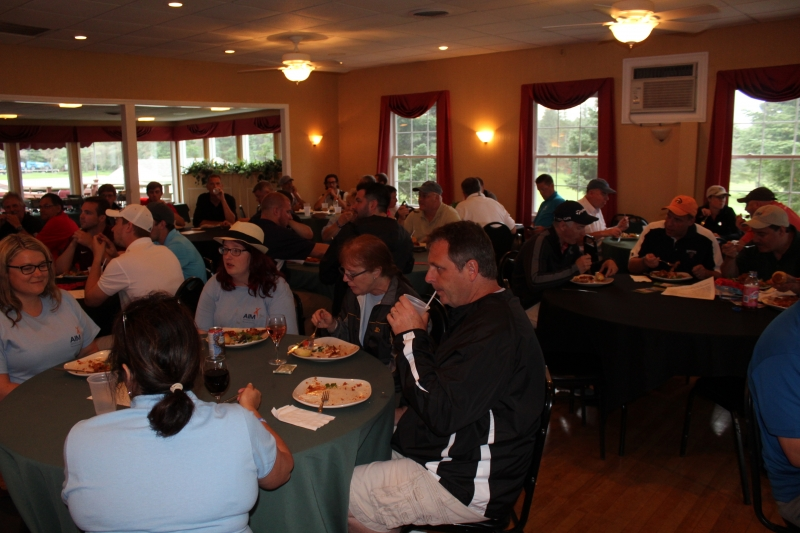 golfers eating food in the clubhouse