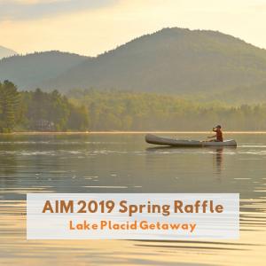 AIM Spring Raffle man on canoe in Lake Placid