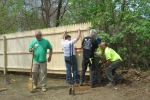 Community collaborations rebuilding fence