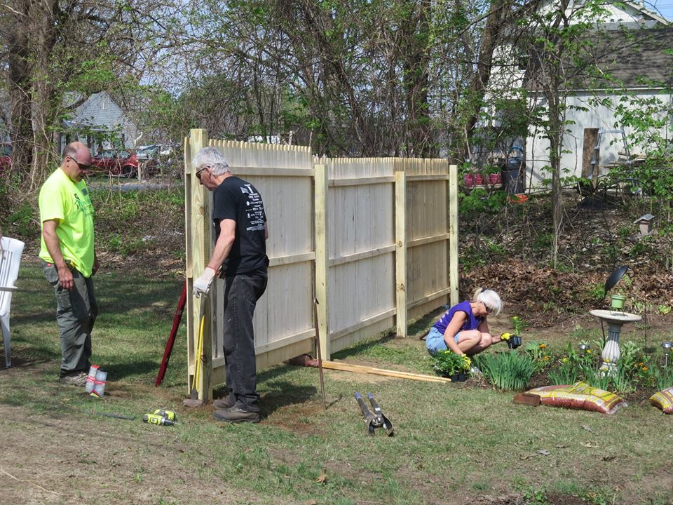 Community Collaborations working on fence