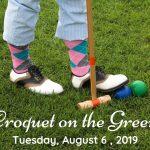 feet lining up croquet shot