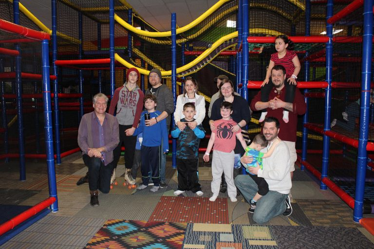 the group poses together at indoor playpen