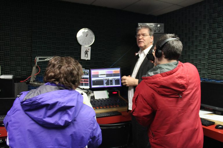 three people inside radio studio