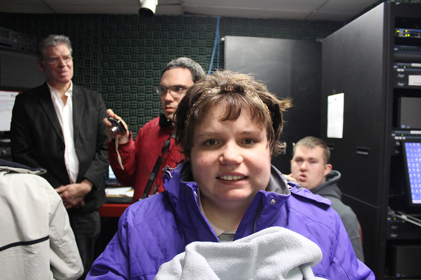 Girl in purple jacket in radio booth