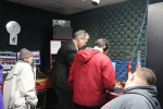 Group gathered around computer in radio booth