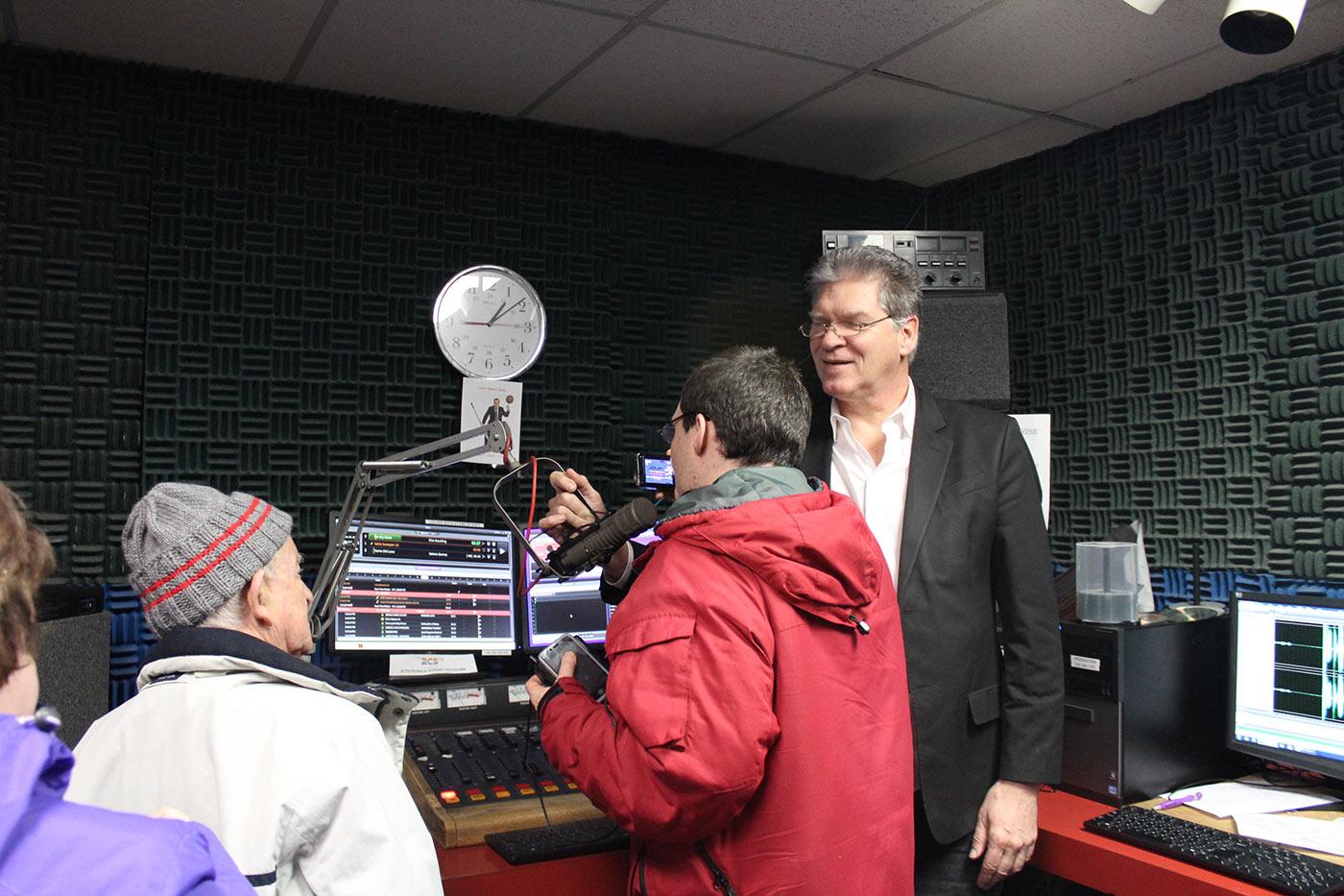 Man talking ibnto mic in radio booth