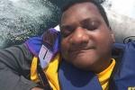 Man sleeping during water ride at Y-Knot sailing program