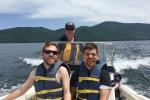 Men water ride during Y-Knot sailing program