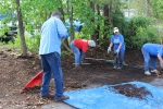 Active senior women and man doing spring clean-up at the backyard