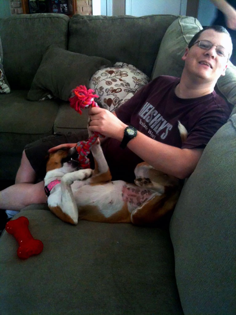 Happy young man with a dog