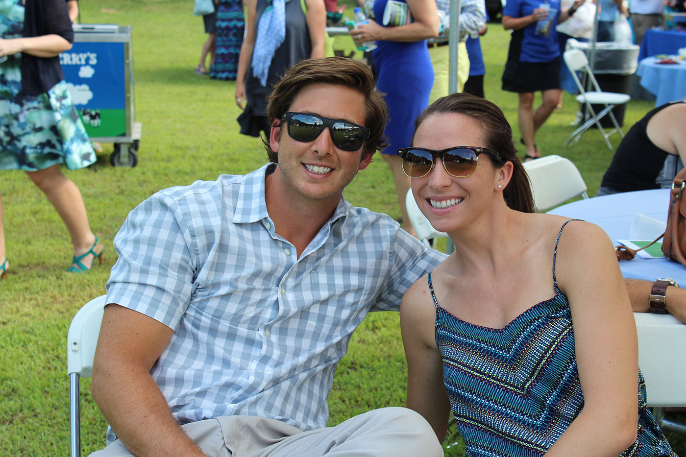 a couple wearing sunglasses smiling