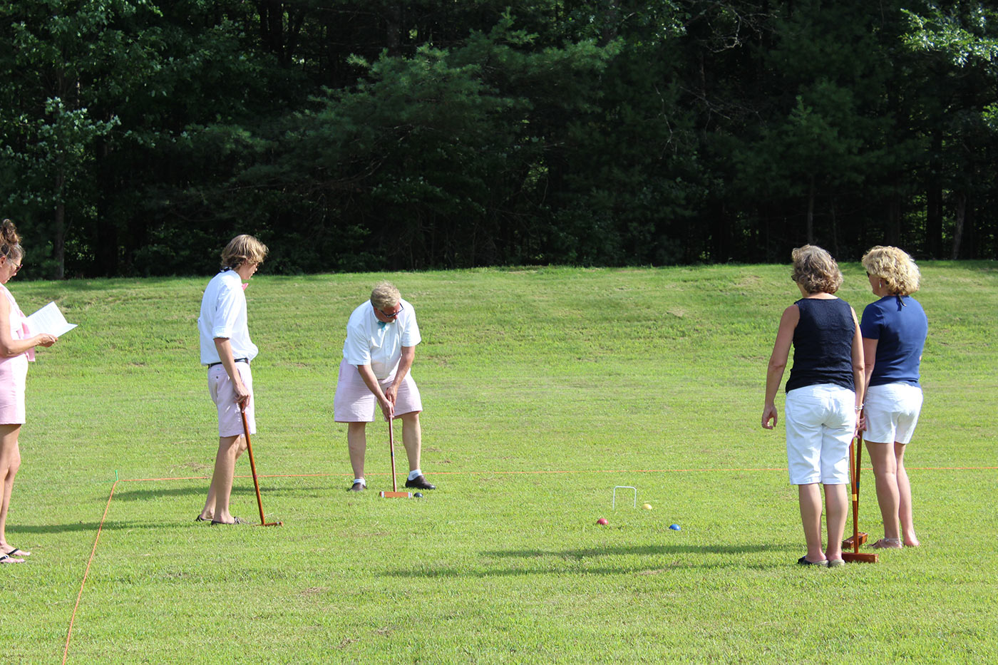 Group of people playing croquet at AIM Services event
