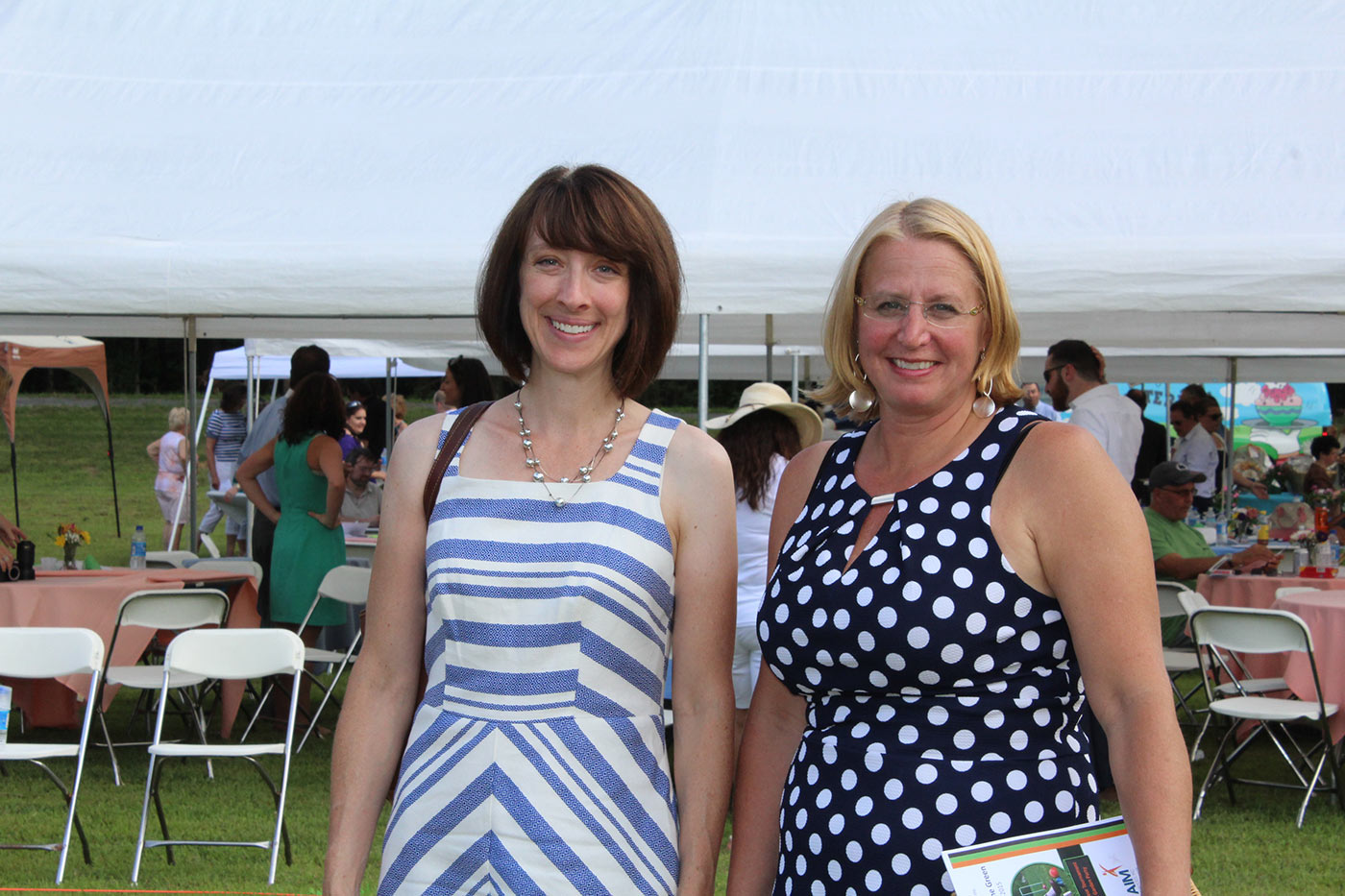 Two women smiling at camera at AIM Services Croquet on the Green event