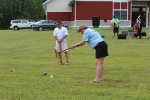 person smacking the croquet ball