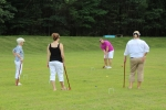 Group of people playing croquet at Croquet on the Green event