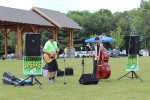 Legendary losers playing guitar at AIM Services Croquet on the Green event