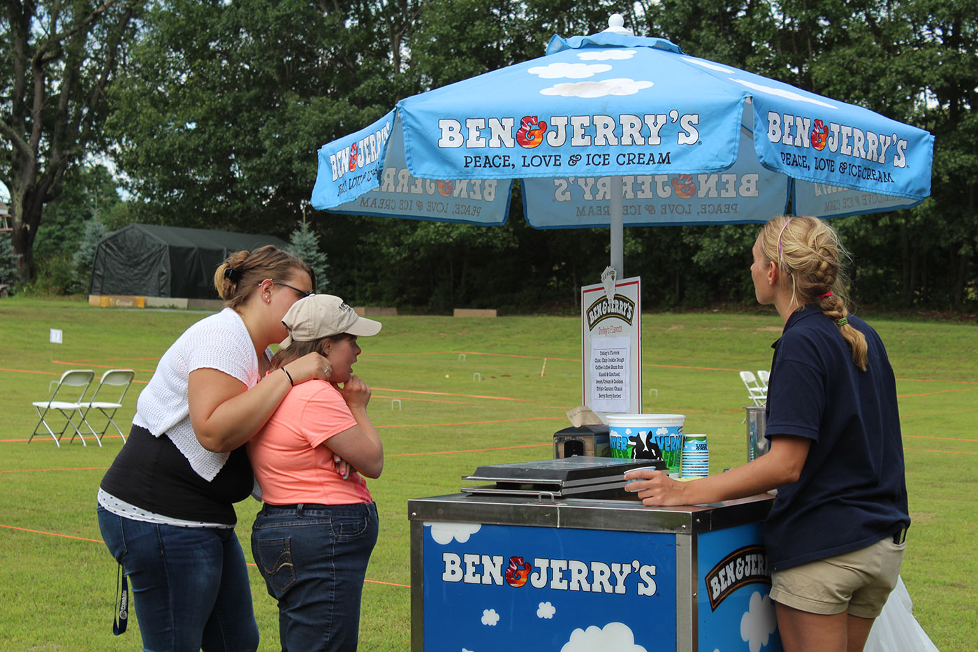 two women going up to ben and jerrys cart to grab some ice cream