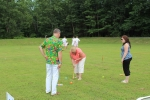People playing croquet at AIM Services Croquet on the Green event