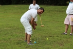 man in white hitting light blue ball
