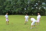 person in white lining up to hit the ball through the wicket