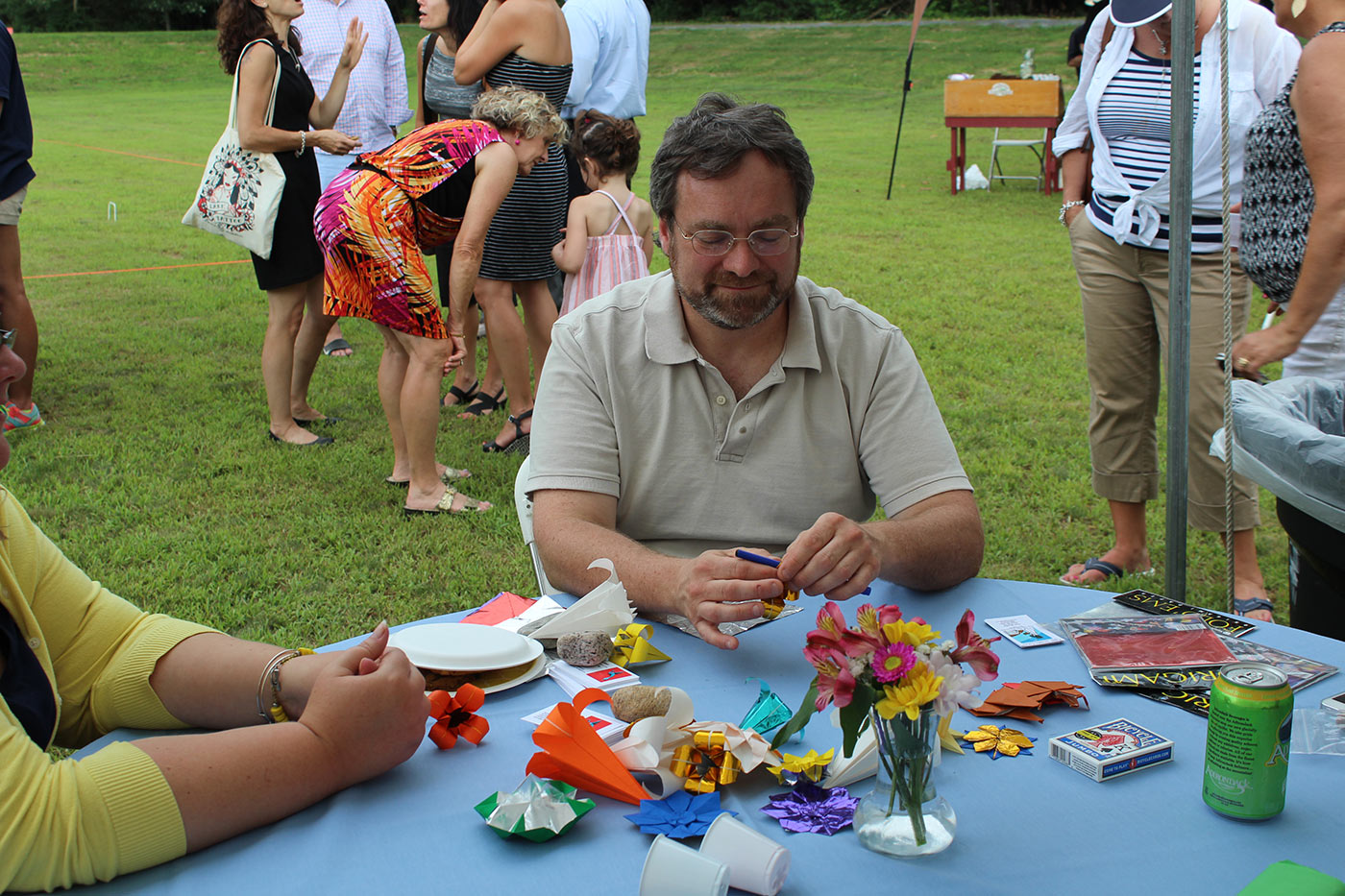 man making origami
