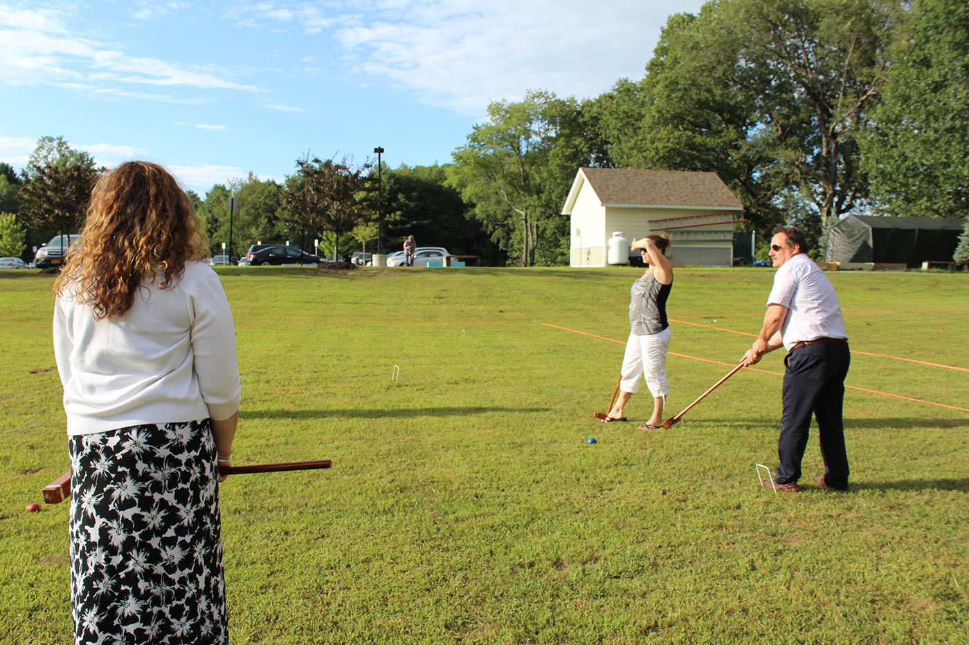 three people on the croquet field
