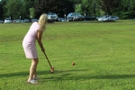 woman in pink hits red ball
