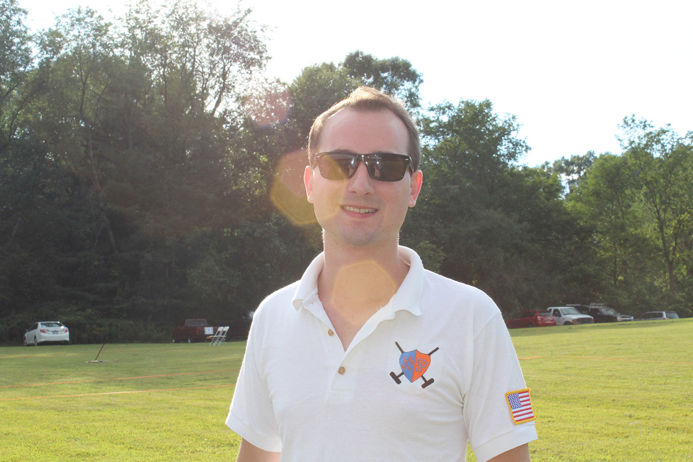 man wearing white croquet polo