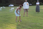 woman in striped dress hitting ball